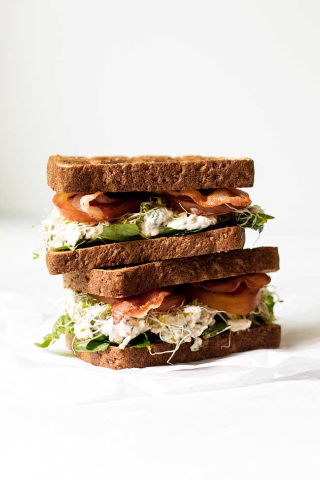 Two blue cheese chicken salad sandwiches stacked on top of each other