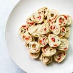 Roasted red pepper & basil pinwheels on a plate
