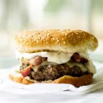 Bacon cheeseburgers dressed up with creamy green chile mayo