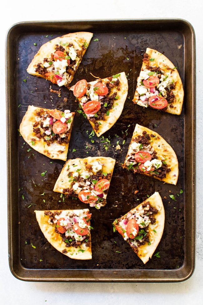 Slices of chorizo and goat cheese pita pizza
