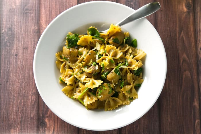 Eggplant with Buttery Rosemary Pasta in white bowl with fork