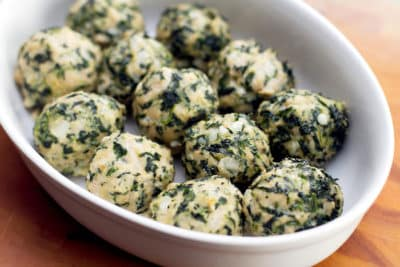 chicken and spinach meatballs in a serving bowl