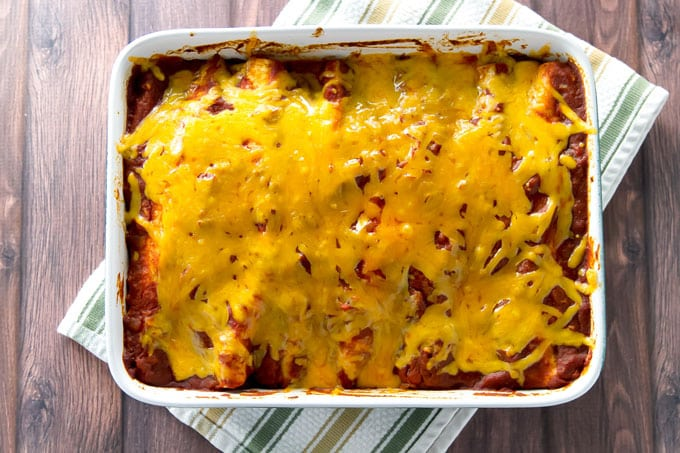 overhead photo of a a baking dish with chicken enchiladas
