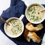 Two bowls of roasted cauliflower and kohlrabi soup
