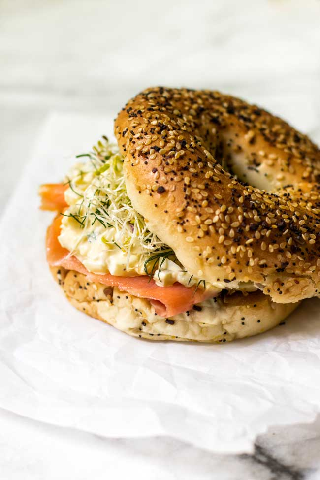 smoked salmon egg salad on an everything bagel