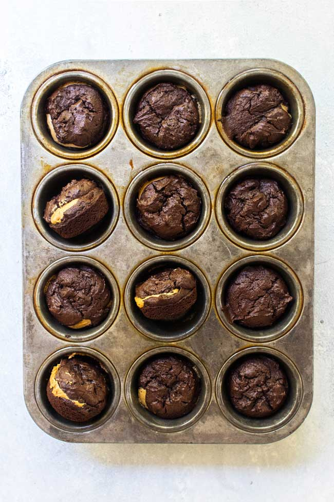 Baked peanut butter brownies in a muffin tin
