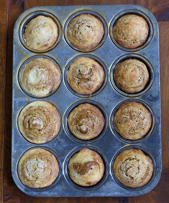 Pumpkin Muffins with Cream Cheese in muffin tin
