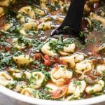 close-up photo of a pot of tortellini soup