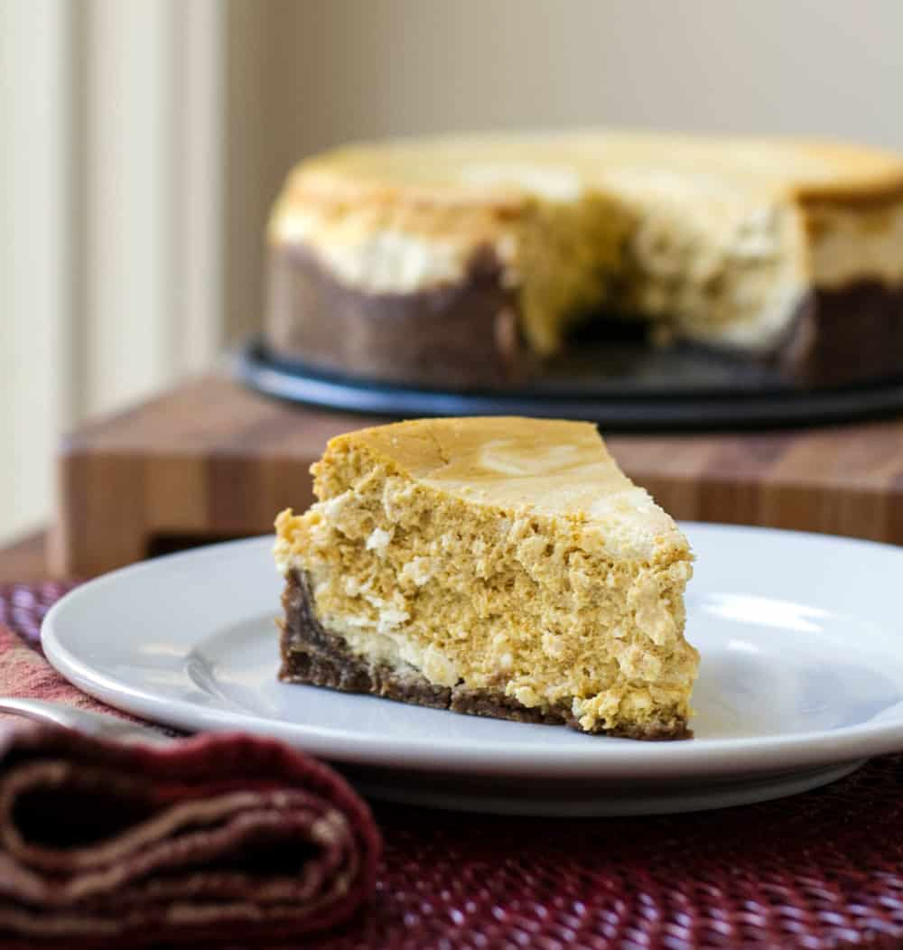 A slice of pumpkin cheesecake on a plate