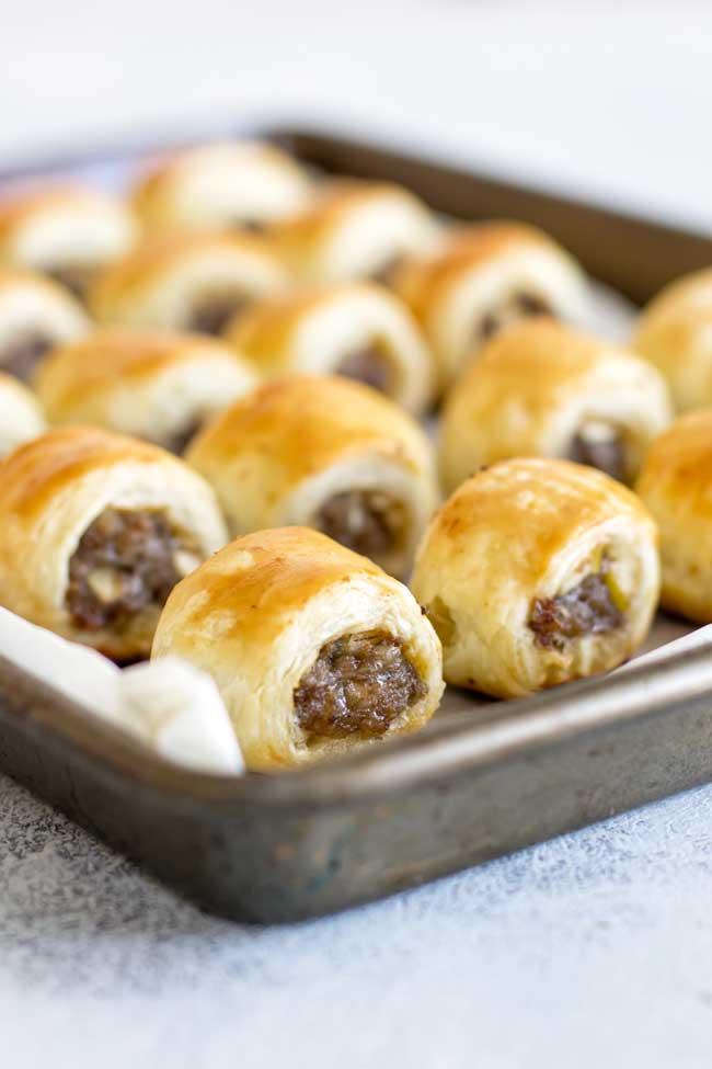 photo of pork sausage rolls on a baking sheet