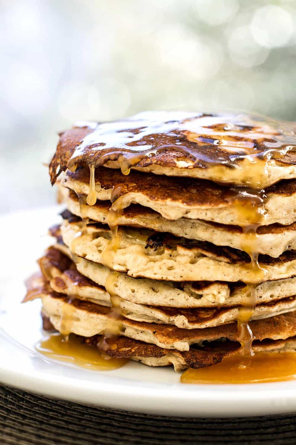 Stack of banana pancakes topped with maple butter glaze