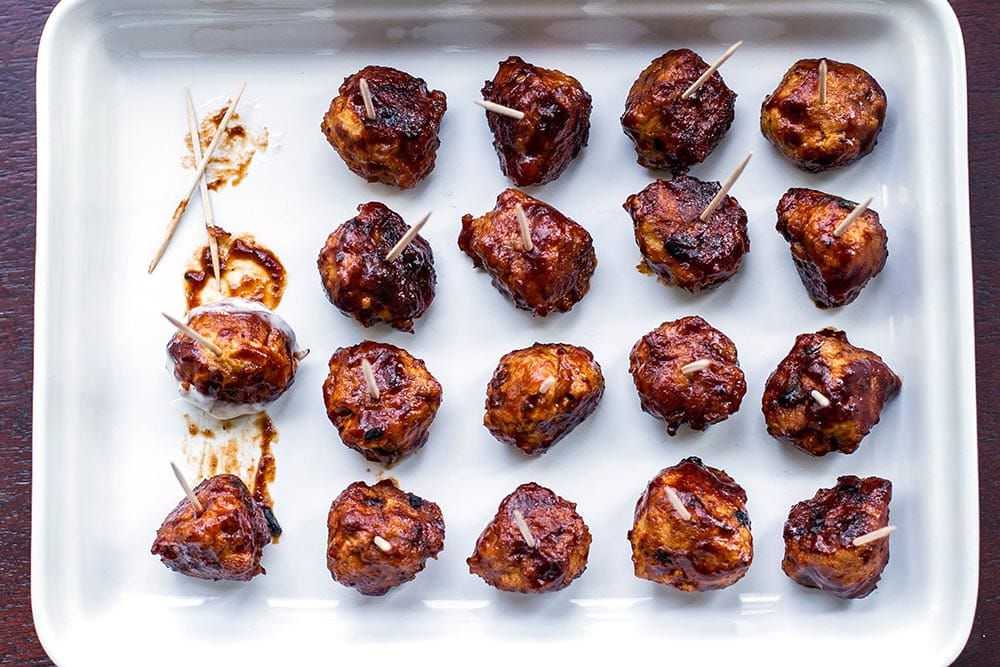 Honey BBQ chicken meatballs on a white platter