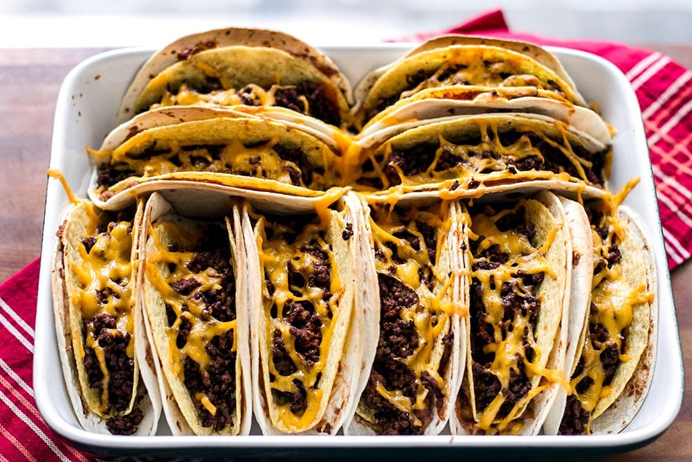 Baked double decker tacos in a baking dish