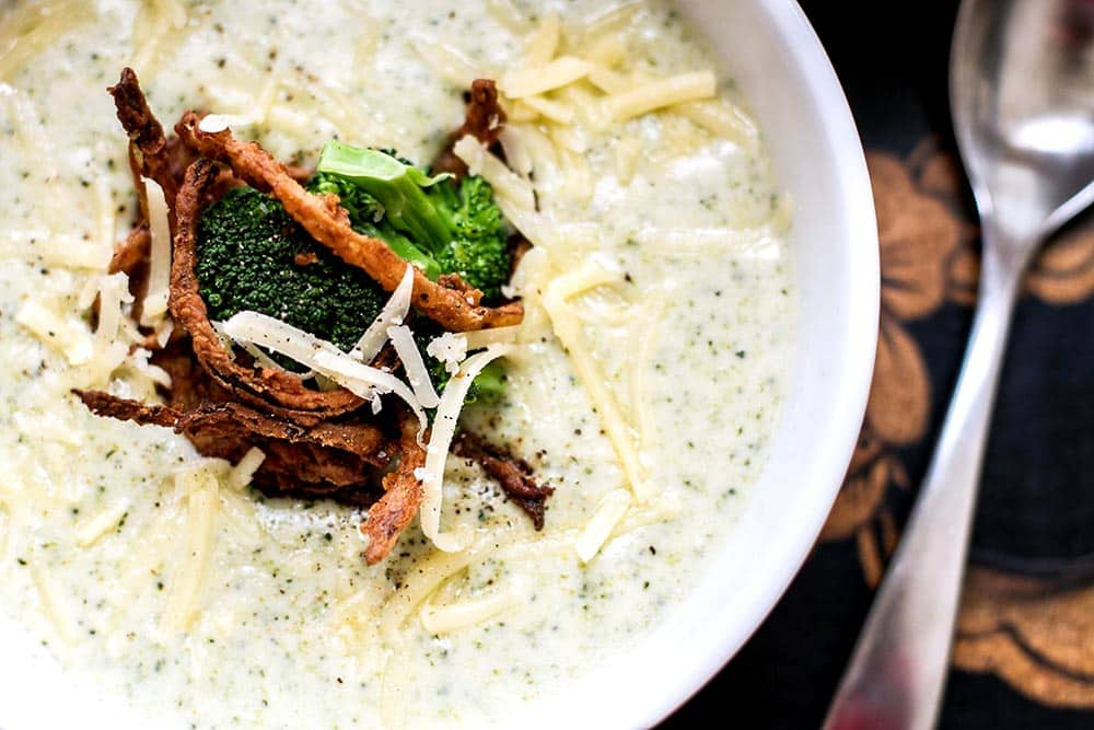 Creamy broccoli cheese soup with a crispy onion garnish.  It's perfect for a cold wintry day!