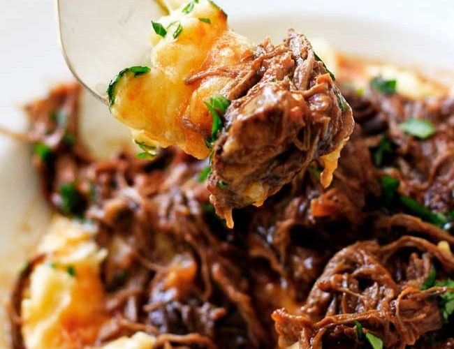 A forkful of short rib ragu with parmesan mashed potatoes