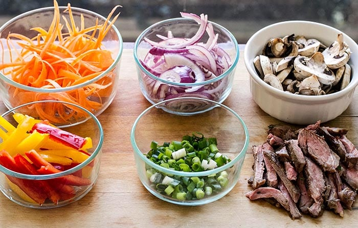 photo of bowls of prepped veggies and sliced beef