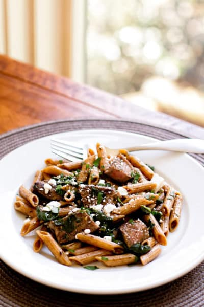 photo of a plate of steak pasta