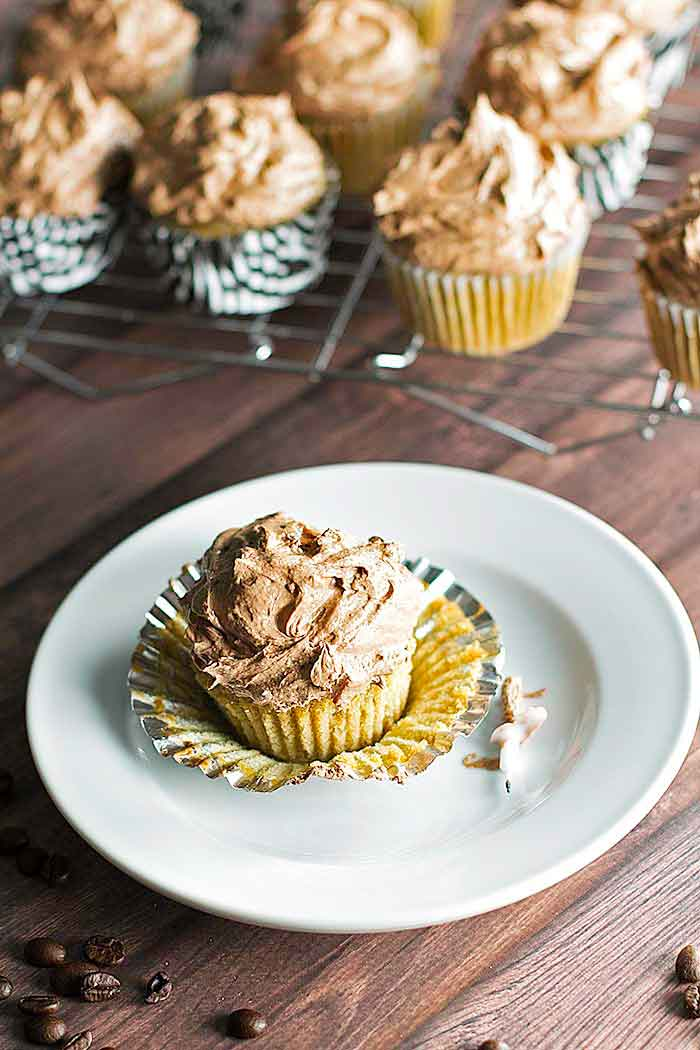 a coffee cupcake with chocolate buttercream frosting on a plate