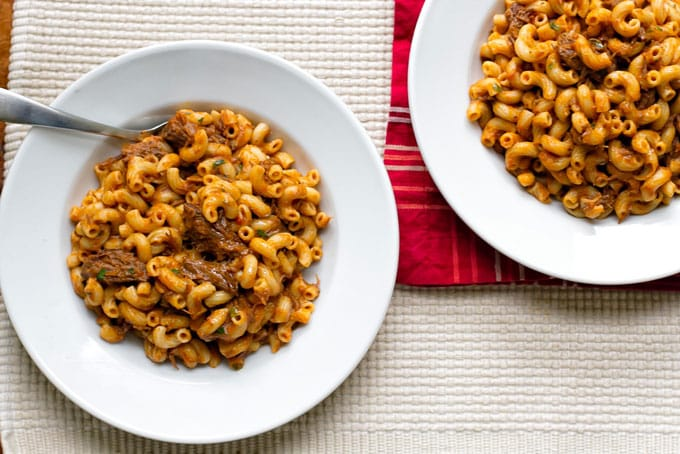 Two servings of grown-up beefaroni in white bowls