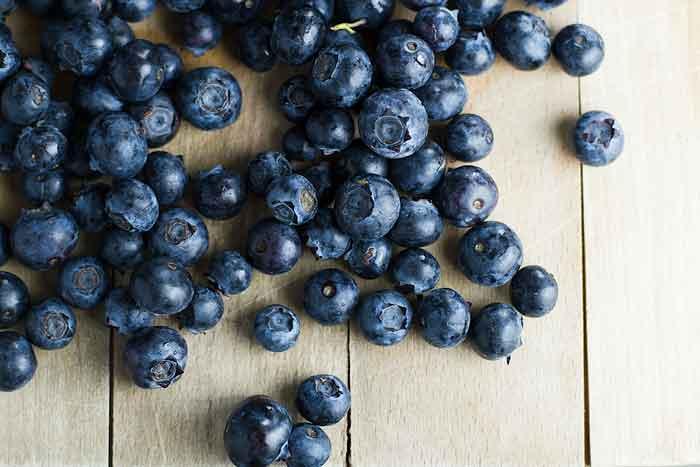 fresh blueberries on a cutting board