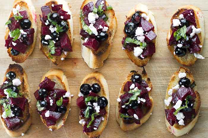 Beet & Blueberry Bruschetta on a cutting board