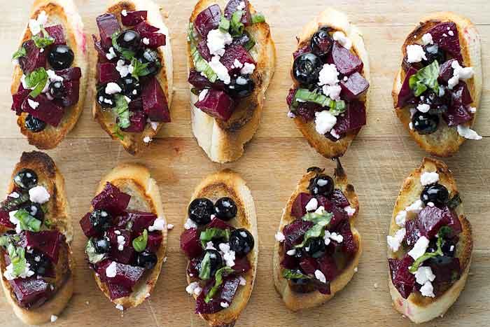 Beet & Blueberry Bruschetta on a cutting board