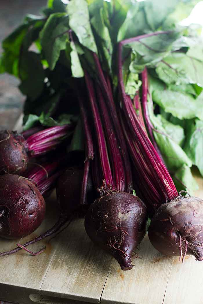 fresh beets on a cutting board