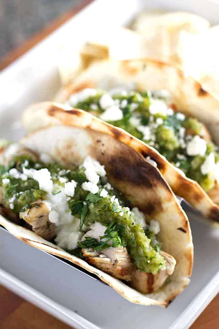 photo of chicken tacos topped with salsa verde