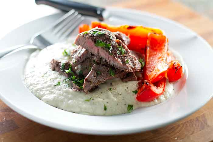 Grilled steak on eggplant puree with red peppers