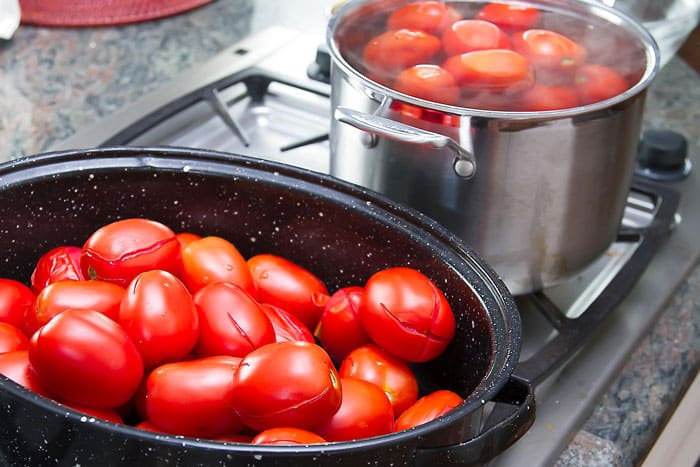 tomatoes ready to be blanched in boiling water