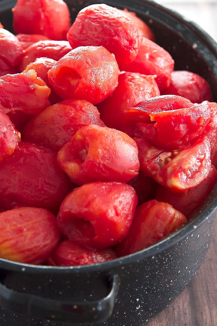 blanched and peeled tomatoes in a big container