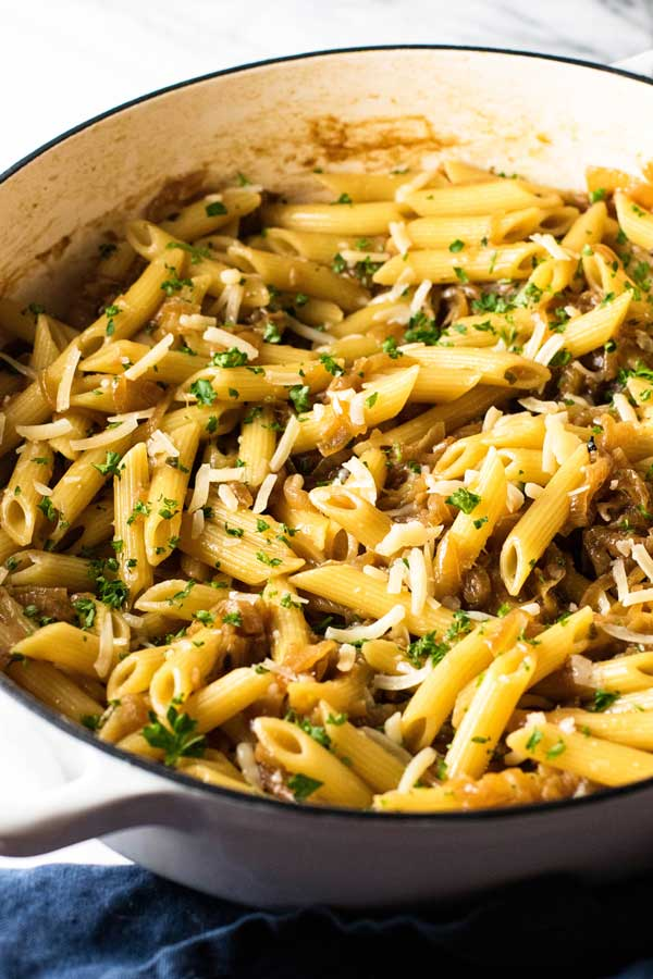 caramelized onion pasta in a white skillet