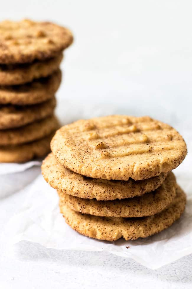 Stacked peanut butter cookies spiced with nutmeg, cloves, sugar, and cinnamon