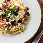 A quick and easy pasta dish with olives, artichoke hearts, sundried tomatoes, and creamy feta cheese - on the table in 15 minutes!   girlgonegourmet.com