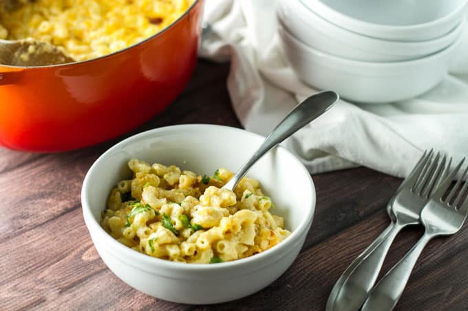 Double Cheddar Macaroni and Cheese in a white bowl with a fork