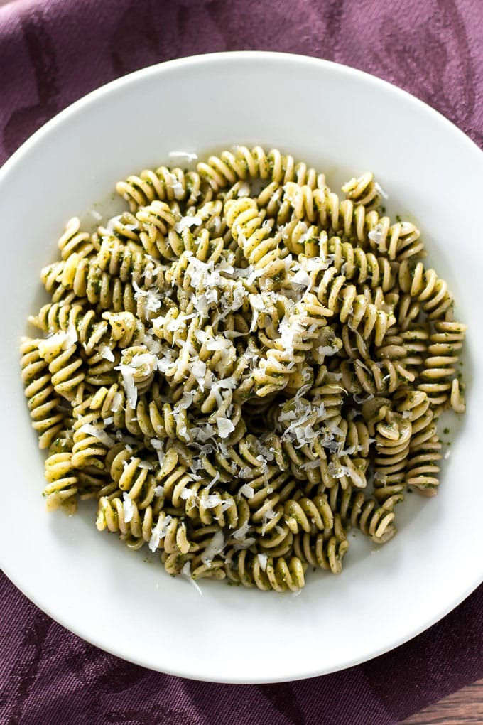 beet tops pesto with pasta in a white bowl