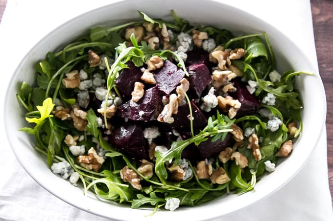 roasted beet salad in a white serving dish