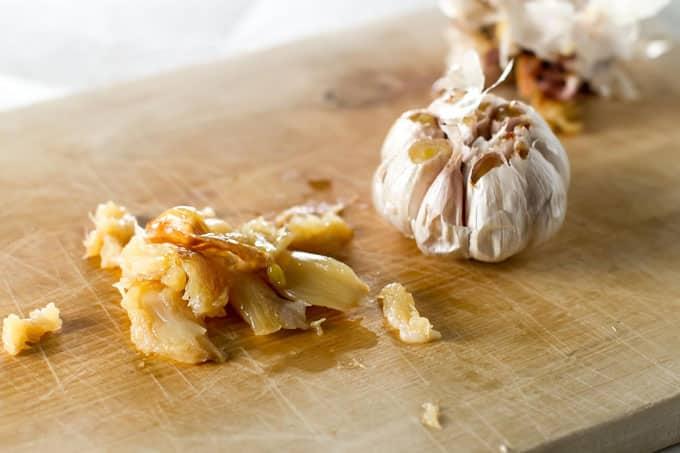 Roasted garlic on a cutting board