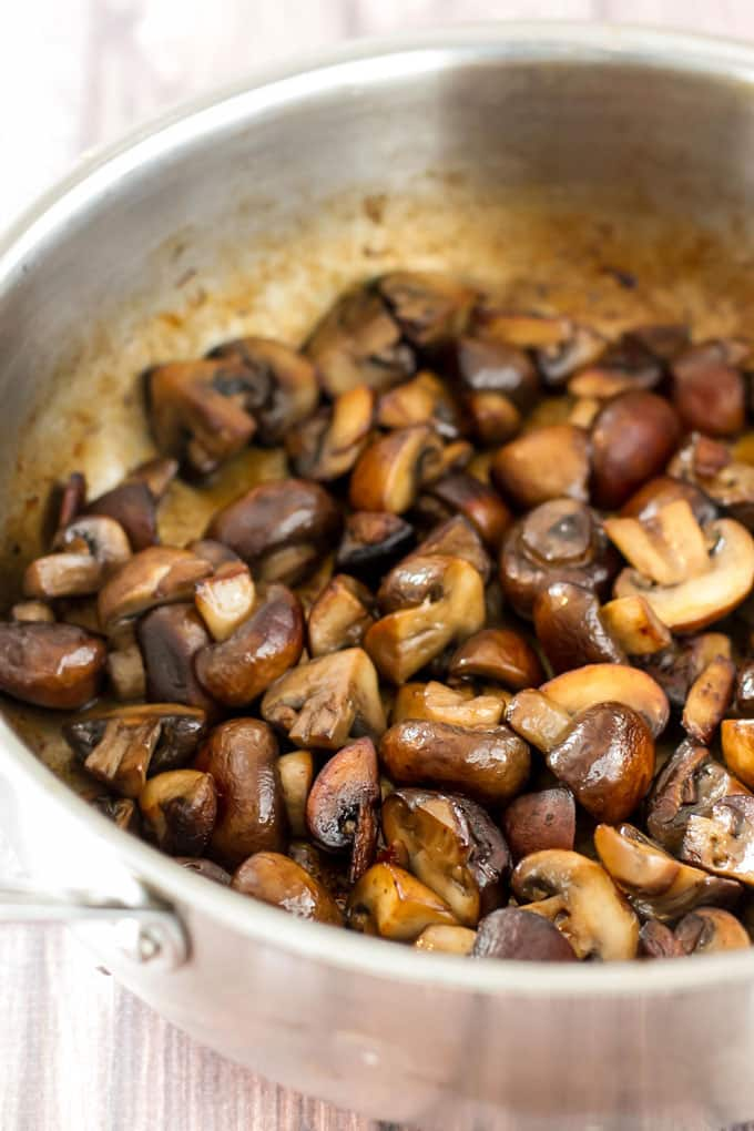 A skillet with cooked mushrooms