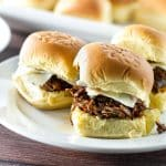 Use your slow cooker to make a big batch of tender short ribs - pile it high on rolls for a great game day snack!   girlgonegourmet.com