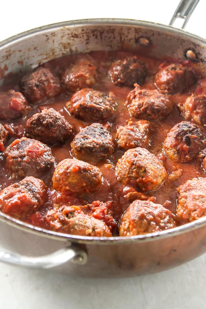 Meatballs and tomato sauce in a large skillet