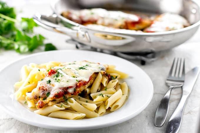 chicken parmesan served on pasta
