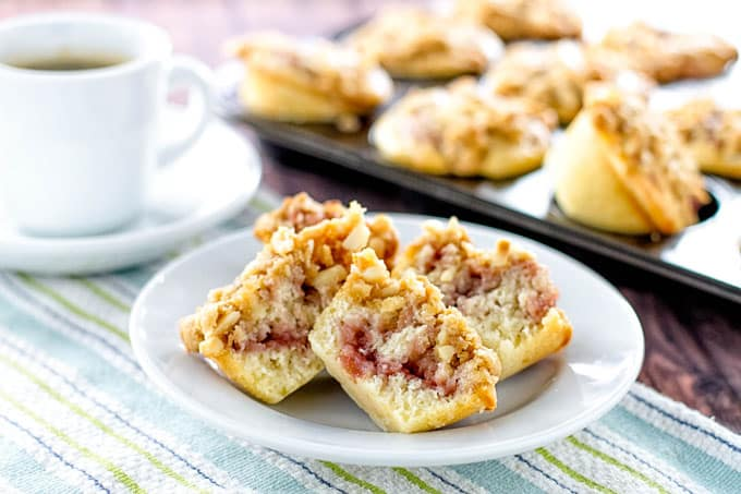 strawberry swirl muffins on a white plate