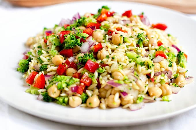 A simple orzo pasta salad with broccoli, bell pepper, red onion & chickpeas tossed in a light lemon dijon vinaigretter | get more salad recipes! www.pinterest.com/april7116/salads/