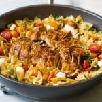 photo of balsamic glazed chicken in a skillet with caprese pasta