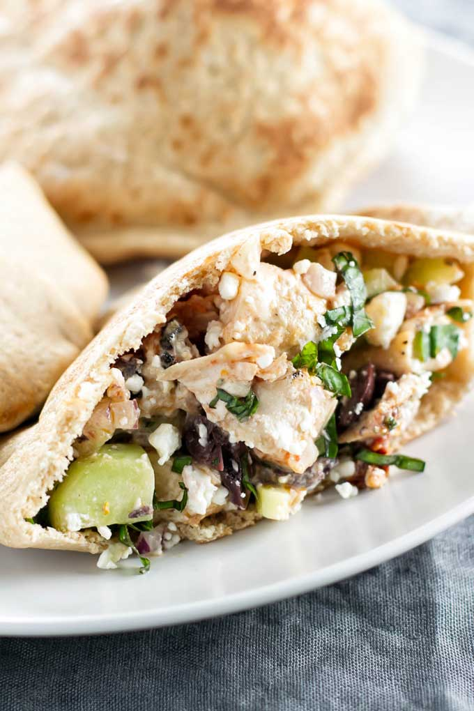 Greek pitas with chicken, sundried tomatoes, olives, cucumber and a creamy cool yogurt dressing | girlgonegourmet.com