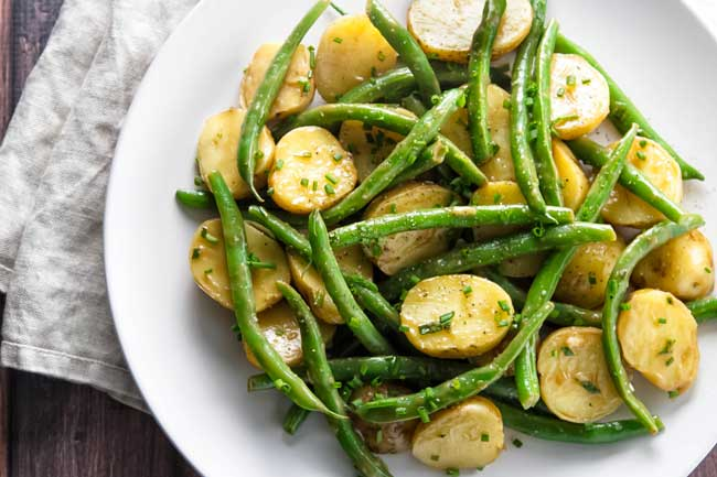 Green bean potato salad on a white plate