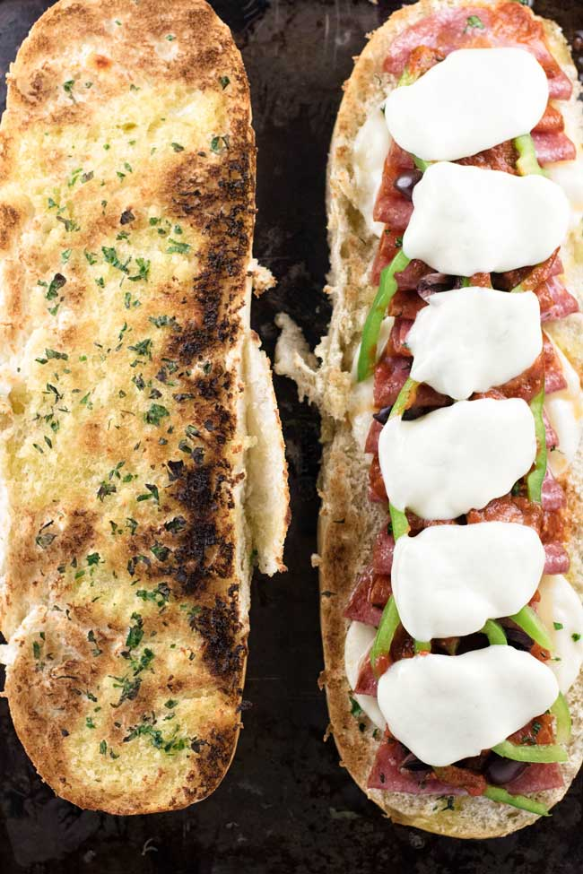 loaded pizza sandwiches on toasted bread