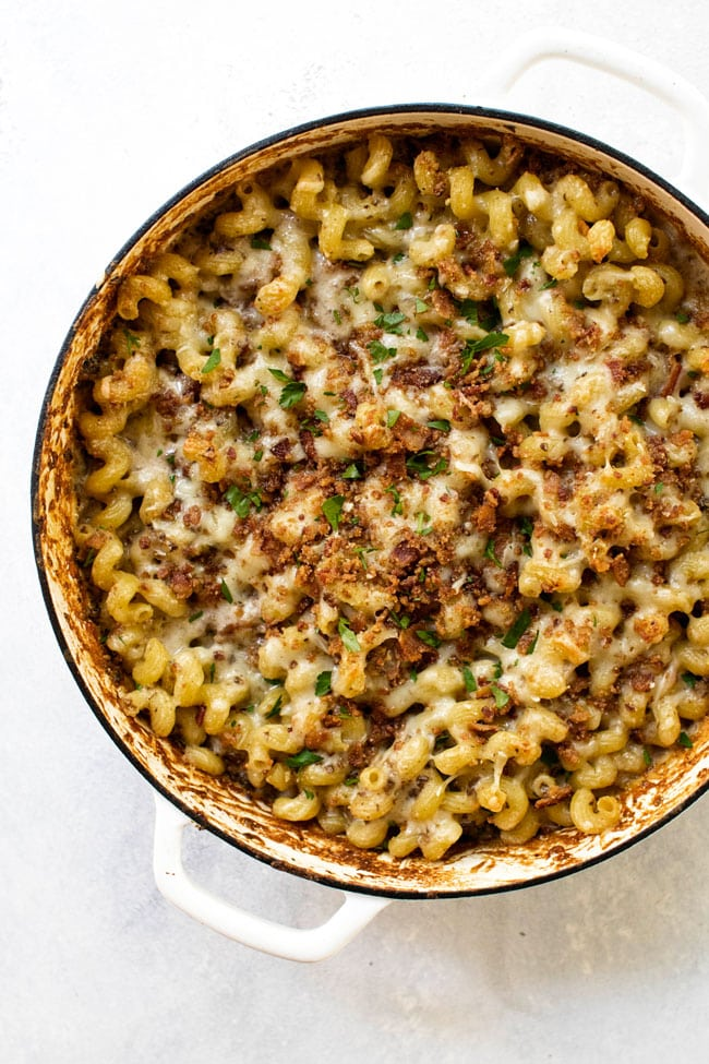 Overhead shot of mushroom macaroni and cheese in a white oven-safe pan