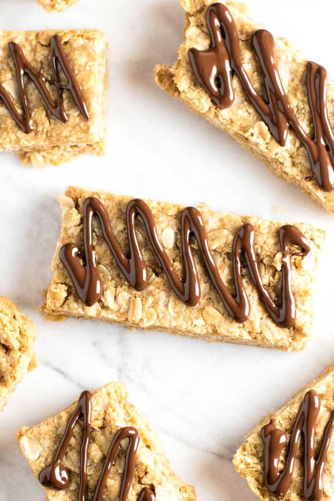 overhead photo of peanut butter oatmeal bars drizzled with chocolate